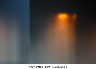 Empty wall of the room lit by orange sunset light. Abstract background