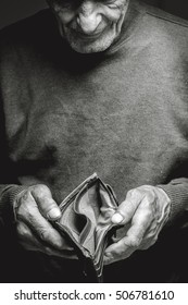 Empty wallet in the hands of an elderly man. Poverty in retirement concept. Black and white.B&W