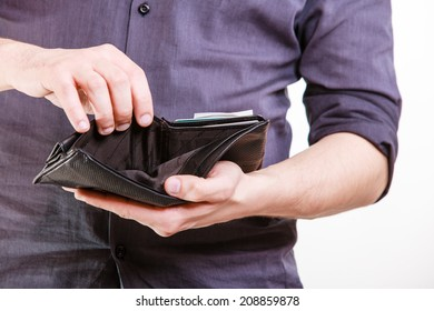 Empty wallet in male hands as symbol poverty and unemployment. Finance and poor economy. Isolated on white. Studio shot.