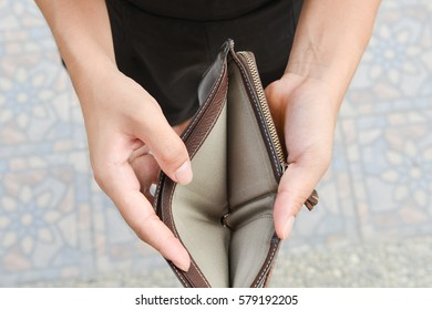 Empty wallet on a woman's hand