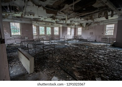 Empty ward with beds at an abandoned and derelict lunatic asylum/hospital (now demolished), Cane Hill, Coulsdon, Surrey, England, UK