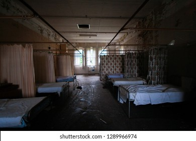 Empty ward withs beds and curtains at an abandoned mental asylum, Cane Hill, Coulsdon, Surrey, England, UK