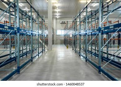 Empty warehouse shelves in grey interior