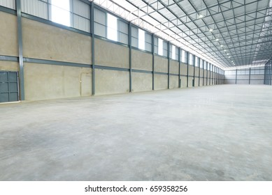 Empty warehouse structure made with strong construction of concrete, iron and metal.