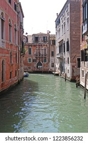 Empty Water Canal With Traditional Buildings in Venice Italy