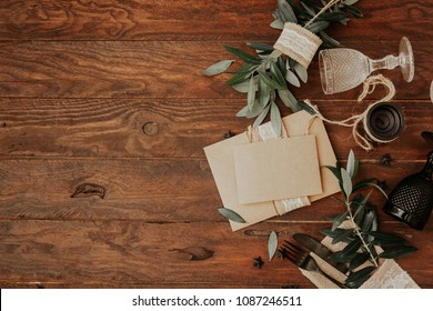 Empty wedding card on plate with rustic wedding decorations. Rural organic eco style. Top view, flat lay