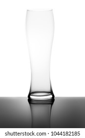 Empty Weizen Wheat Beer Glass and Reflection Isolated on White Background