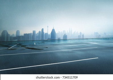 Empty wet asphalt road with foggy city skyline background , raining day .