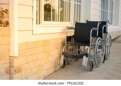 Empty wheel chair in hospital. With sun light on the right.