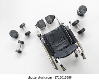 Empty wheelchair in gym for disabled person