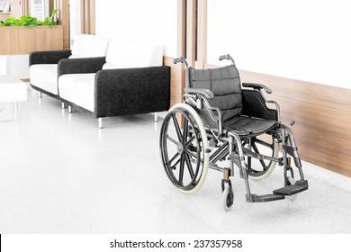 Empty wheelchair parked in hospital hallway
