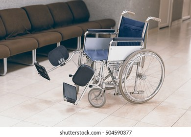 Empty wheelchair parked in hospital. Wheelchairs use for patient disabled. Wheelchair parked in hospital hallway