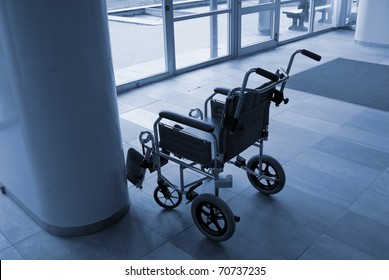 Empty wheelchair ready for use near a hospital entrance - Denmark.