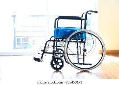 Empty wheelchair standing alone in a room. Wheelchair park in hospital room.
