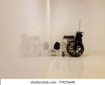Empty wheelchair in white room with blurred, Health care concept