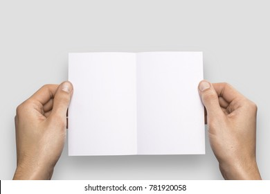 Empty white A6 postcard horizontally. Man holds a pattern in his hand on a gray background