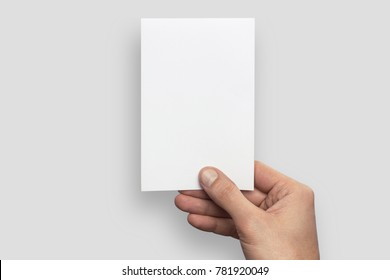 Empty white A6 postcard vertically. Man holds a pattern in his hand on a gray background