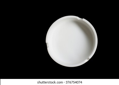 empty white ashtray isolated black background