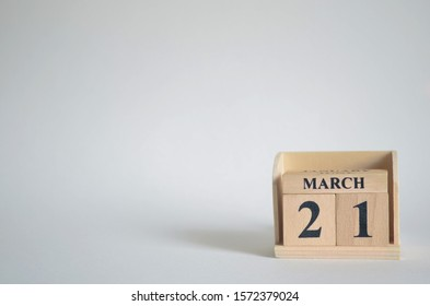 Empty white background with number cube on the table, March 21.