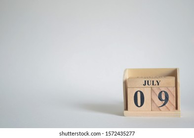 Empty white background with number cube on the table, July 9.