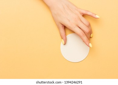 Empty white beer round coaster holds in female hand