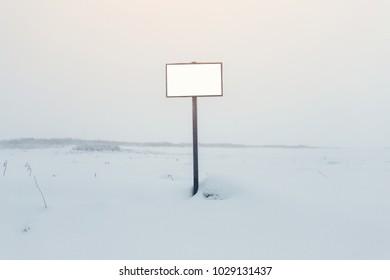 Empty white billboard on Beautiful landscape of the Snow with Tundra arctic in Teriberka ,Russia.