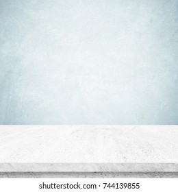 Empty white cement table over blue cement wall background, banner, product display montage