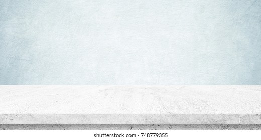 Empty white cement table over blue cement wall background, banner, table top, shelf, counter design for product display montage