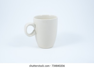 Empty white ceramic  coffee or tea cup isolated on white background