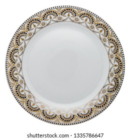 Empty white ceramic dinner plate with golden ornament border from above isolated on white.