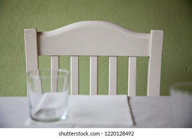 Empty white chair near table