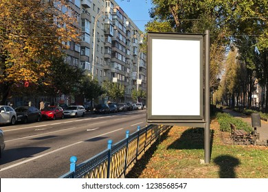 empty white citylight on the boulevard near the road. blank vertical billboard on the street during autumn, Blank white template for design solutions