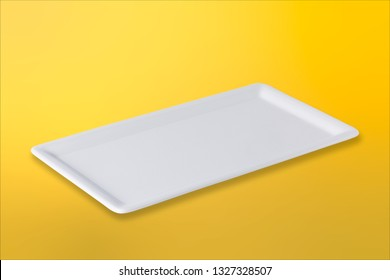Empty white cornered plate on gradient yellow orange background, front view, oblique position