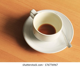 Empty white cup of hot coffee latte on wooden table