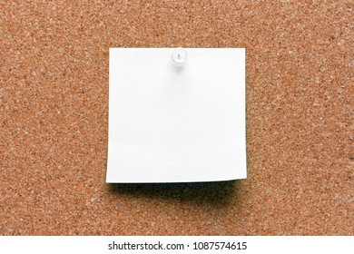 empty white green pinned sheet on a brown cork reminder