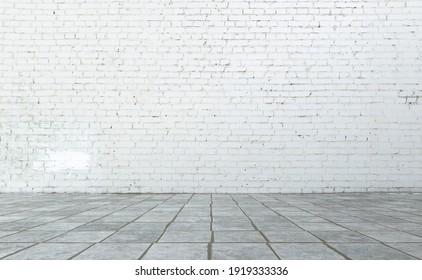 empty white interior, bricks wall, tiled floor.