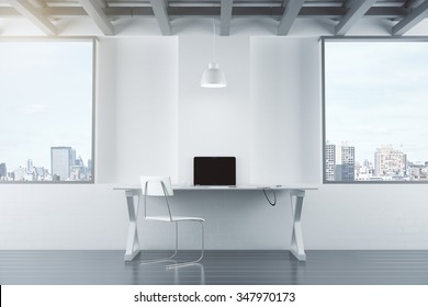 Empty white interior with table, chair, brick wall and windows, and laptop 3D Render