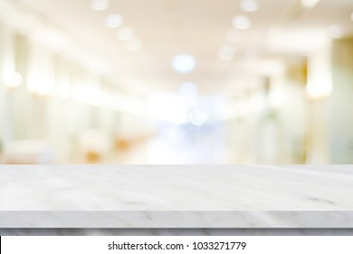 Empty white marble over blur store background, product display montage