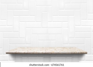 Empty white marble shelf at white ceramic tile wall background,Mock up for display or montage of product or design.
