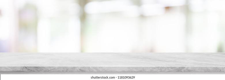 Empty white marble Stone table top and blurred bokeh lighting in interior banner background - can used for display or montage your products.