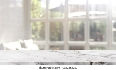 Empty white marble stone table top on blurred with bokeh cafe and restaurent interior background - can be used for display or montage your products