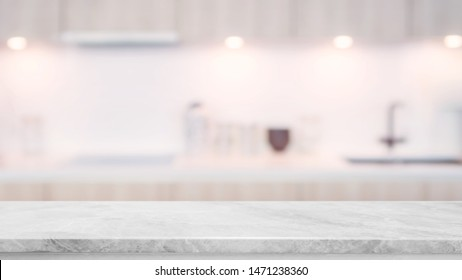 Empty white marble stone table top and blurred kitchen interior background with vintage filter - can used for display or montage your products.