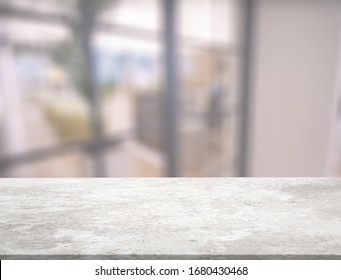 Empty white marble stone table top on an interior background