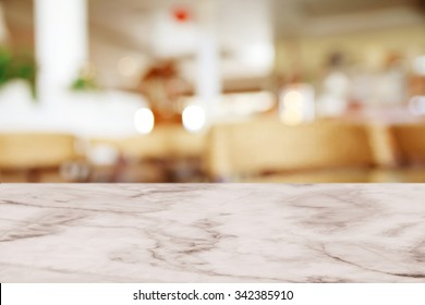 Empty white marble table with blur cafe background.