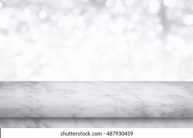 Empty white marble table on white bokeh background. For display or montage your products.