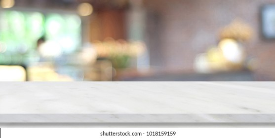 Empty white marble table over blur cafe, restaurant, background, product and food display montage