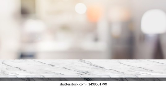 Empty white marble table top food stand with blur house kitchen background bokeh light,Mock up for product display or montage of design,Banner for advertise on online media