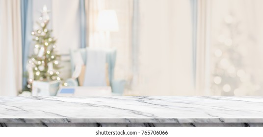 Empty white marble table top with abstract warm living room decor with christmas tree blur background with bokeh light,Holiday backdrop,Mock up banner for display of advertise product ,luxury house