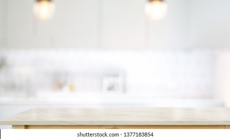 Empty white marble top table in modern kitchen room background. For product or food montage