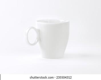 empty white mug on white background